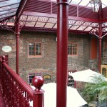 victorian_style_roof_canopy_and_cast_metal_balcony_with_staircase